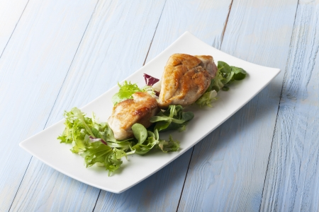 slices of stuffed chicken breast on risotto  Stock Photo - 17086811