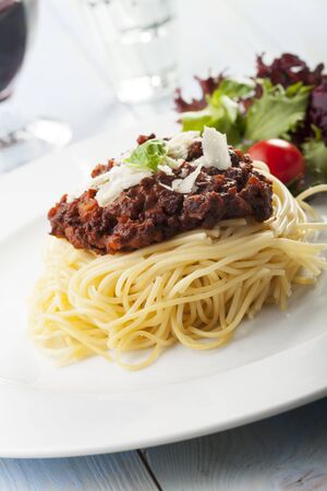 spaghetti with sauce bolognese and basil  Stock Photo - 17318202