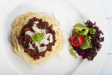 spaghetti with sauce bolognese and basil  Stock Photo - 17318205