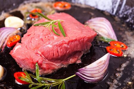 raw steak in an iron pan  Stock Photo - 17752421