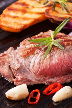 grilled steak in an iron pan  Stock Photo - 17752416