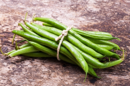 bunch of garden beans on wood  Stock Photo - 17871703