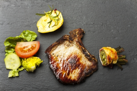 grilled chop of meat on slate  Stock Photo - 17871704