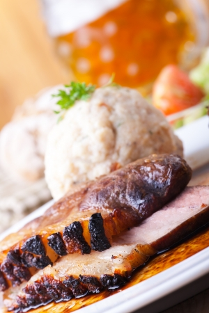 bavarian roast pork dish with dumplings  photo