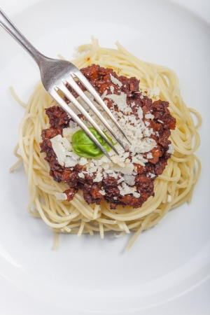 spaghetti with sauce bolognese and basil  Stock Photo - 18118469