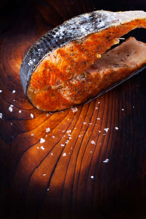 grilled salmon steak on wood  Stock Photo - 18937551