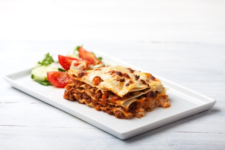 italian lasagna on a square plate  photo