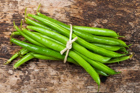 bunch of garden beans on wood Stock Photo - 18937558