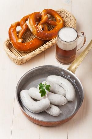 bavarian white sausages with pretzel  photo