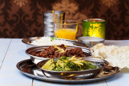 indian murgh palak and dhal with rice  photo
