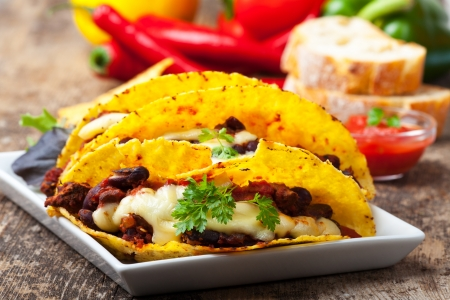rustic food: taco with chili con carne in a bowl