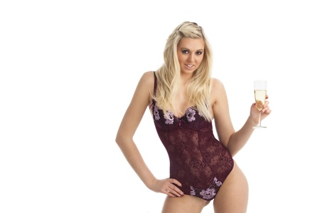 young woman in a corsage with champagne  photo