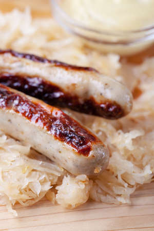 grilled sausages with sauerkraut  Stock Photo - 19086947