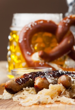 grilled sausages with sauerkraut  Stock Photo - 19087047