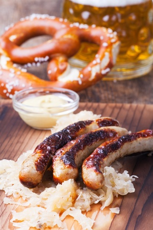 grilled sausages with sauerkraut  Stock Photo - 19154366