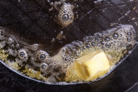 butter melting in a pan Stock Photo - 19154373