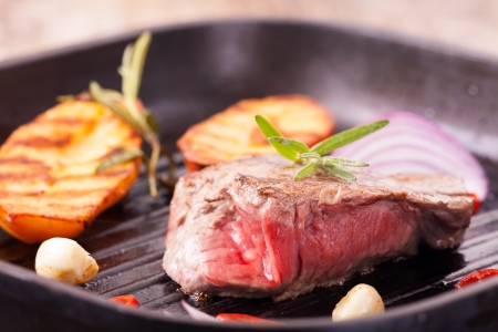 grilled steak in an iron pan  Stock Photo - 19154368