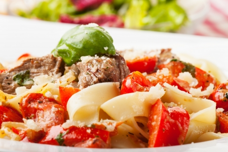 Tagliatelle with steak and tomato Stock Photo - 19211320