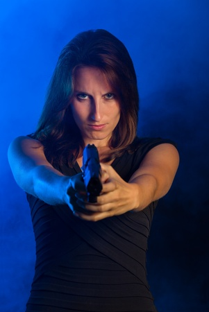 business woman with a gun  Stock Photo - 19201568