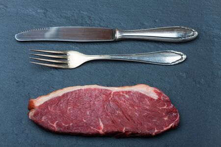 raw steak and cutlery Stock Photo - 19385116