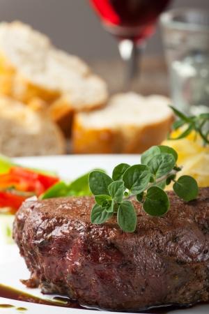 grilled steak with oregano