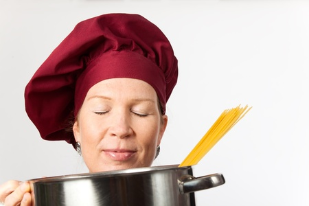 chef with a pot and spaghetti