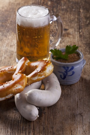 bavarian white sausages with bretzel and beer  photo