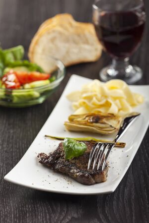 steak with basil and pasta  photo