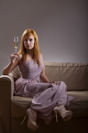 woman in a evening gown with champagne  photo