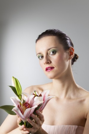 woman with a lily flower  photo