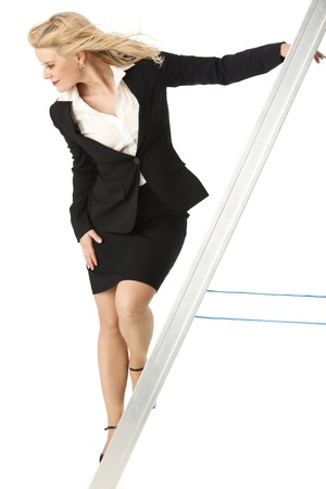 business woman on a ladder on white  photo