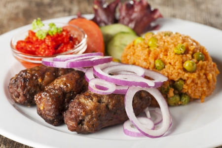 cevapcici with rice and salad