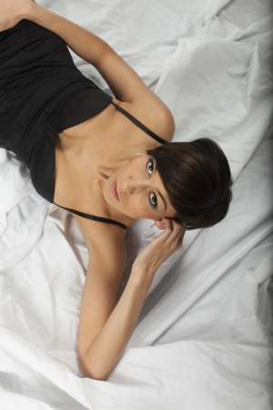 woman in lingery in bed  photo