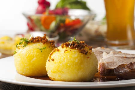 potato dumplings and bavarian roasted pork  photo