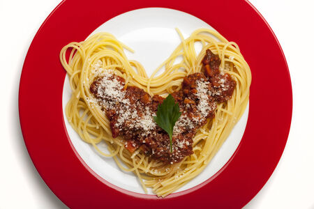 heart shaped spaghetti on a plate  photo