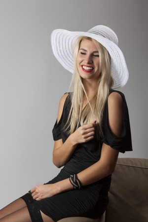 smiling woman with a hat  photo