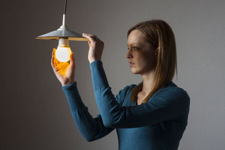 woman with a light bulb  photo