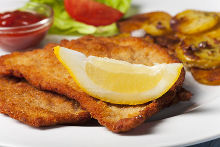 wiener schnitzel with roasted potatoes