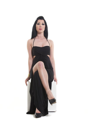 sitting woman in a black evening gown  photo