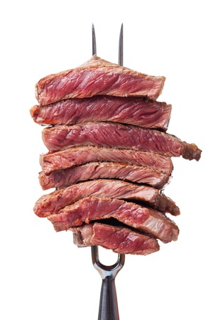 slices of steak on a meat fork