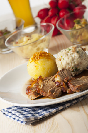 bavarian roasted pork with dumplings  photo