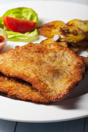 wiener schnitzel with roasted potatoes  photo