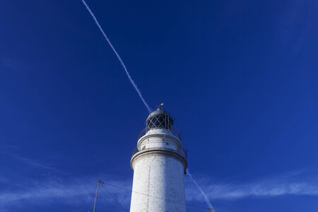 contrail: lighthouse with contrail