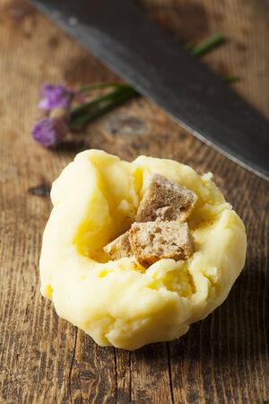 raw potato dumpling on wood  photo