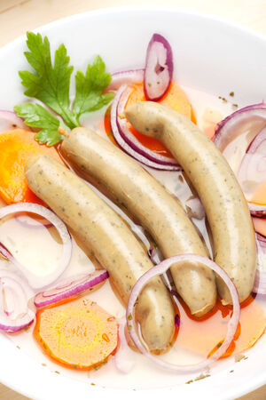 cooked bavarian sausages in a soup  photo