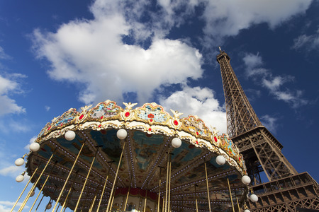 eiffel tower and a carousel  photo