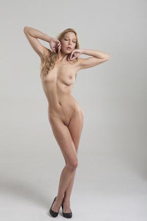 blonde naked woman on grey background  Stock Photo