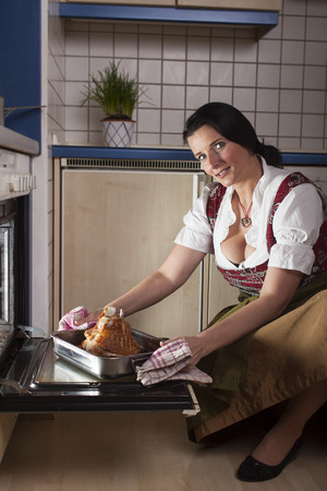 bavarian woman with a knuckle of pork