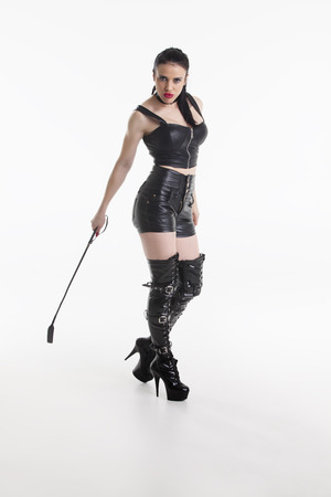 domina in leather with a whip