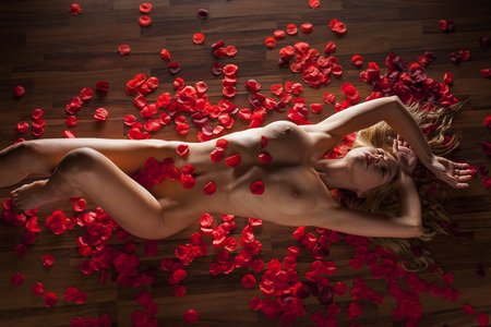 woman on the floor with roses Stock Photo